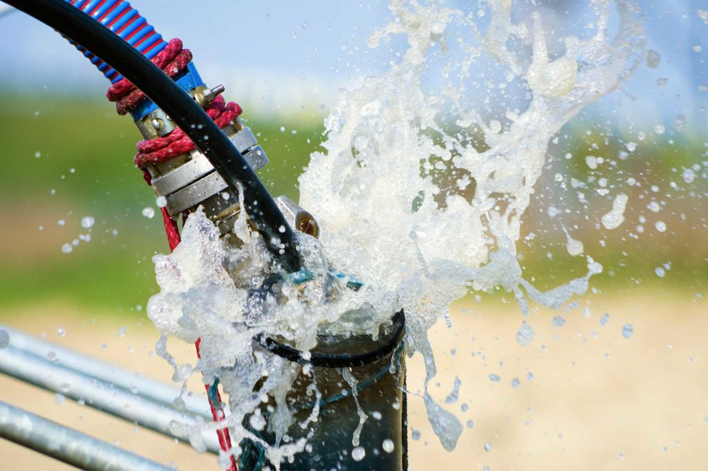 Water well pump installation and servicing
